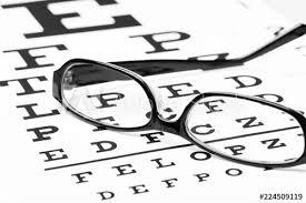 Lying Eye Chart Eye Glasses Lying On Snellen Chart Buy This Stock Photo