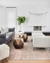 steel gray leather chesterfield sofa with blush pink rug