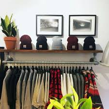 wall mounted clothing rack with top