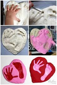 a salt dough handprint and footprint heart keepsake kids can make for pas and grandpas