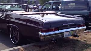 Nice brown 1966 Chevy Impala convertible on color matched ...