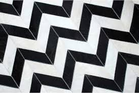 top close up of black and white chevron patchwork cow hide rug