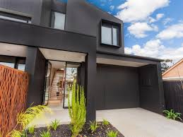 This black clad townhouse in Geelong's inner west is currently on the  market. Its dark faade contrasts with the light, bright interior.