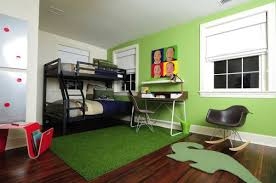 View in gallery Modern kids' bedroom sports bunk beds and a unique desk