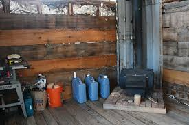 the corner of our cabin where we keep the wood stove we put things by
