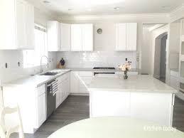 white and gray quartz gray kitchen