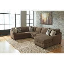 Teak Living Room Furniture Ashley Furniture Justyna Sectional In Teak Local Furniture Outlet