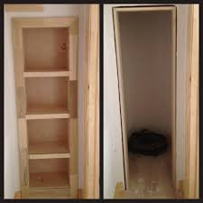 rolling bookshelf door conceals secret closet