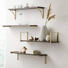 charcoal shelf with brass brackets