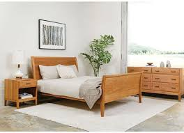 The Contemporary Sleigh bed is handcrafted in Portland, OR using  traditional woodworking techniques. Clean, Modern take on a traditional sleigh  bed.