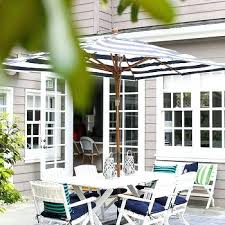 black and white striped outdoor umbrella white x based outdoor dining table and white folding chairs black and white striped outdoor umbrella australia