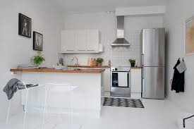 white fridge in kitchen. beautiful single room apartment in the crowded city: wooden countertop and white barstools wonderful fridge kitchen