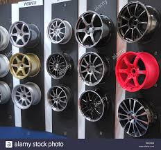Alloy Wheel Display Stand car Alloy wheels on display at an automotive fair Stock Photo 6