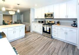 how white shaker cabinets improve your home value kitchen with quartz countertops