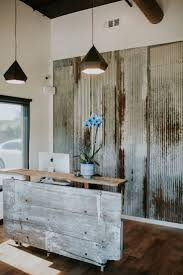 reclaimed rustic reception desk i like the layered textures with the wall and the mix of