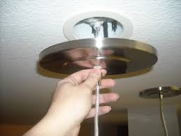 tighten the cover plate to the ceiling and you are done no more can lights