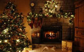 extraordinary decoration of decorating fireplace for showing green garland with white lighting and hanging brown socks on white stone fireplace