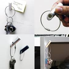interesting magnetic key holder placed on the white wall and grey metal table legs for modern