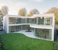 mvrdv recently completed new private residence in rotterdam wrapped by fluid glass walls overlooking a beautiful private garden of the house