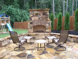 the outdoor fireplace and seating walls are made of tennessee fieldstone low voltage lighting was also incorporated into the walls for a great