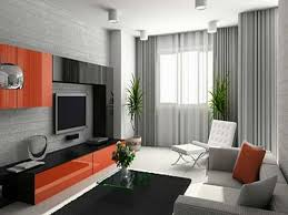 living room grey wall theme added by small rectangle glass table on black rug and