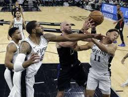 los angeles clippers center marcin gortat 13 battles san antonio spurs forward lamarcus aldridge 12 and guard bryn forbes 11 for a rebound during the