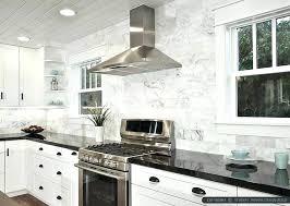white kitchen cabinets with black marble subway tile dark quartz countertops blue mar