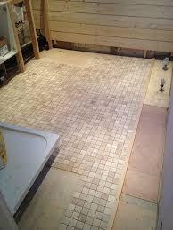 mosaic tiled floor with bathroom installation in leeds