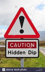 triangular road sign warning caution hidden dip with exclamation mark in red triangle outer hebrides