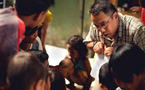 u s department of defense photo essay  u s navy petty officer 1st class felipe tubera teaches english to n children at the murni