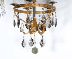 hollywood regency italian neoclassical style brass chandelier with smoked crystal prisms for