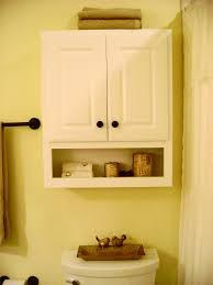 Towel Storage Cabinet Interior Floating White Wooden Cabinet With Double Doors And Shelf Placed On The Yellow Wall Above The Toilet Bathroom Cabinetsjpg