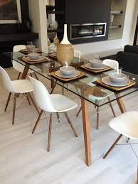 sticotti gl dining table and eames dining chairs in walnut