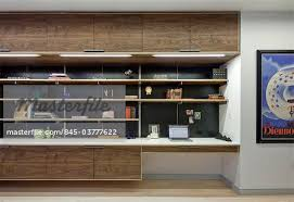 modern walnut built in shelving and storage and desk unit architects we design winston ely stock photo