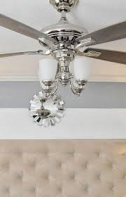 beautiful ceiling fan chrome finish and gray blades with lights that flip up as
