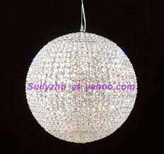 this beautiful crystal ball chandelier consists of thousands of octagonal shaped crystals all brilliantly reflecting the lights of each candle bulb