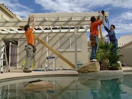working creating patio: add fascia board to end of rafters