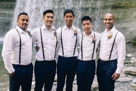groom groomsmen white shirts brown leather suspenders navy pants multicoloured fl onholes woodland waterfall mint wedding