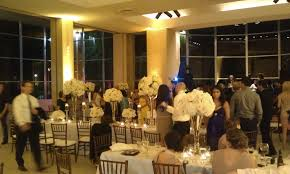 wedding uplighting on columns spread the warmth of candlelight from the gold lighting package from dallas light and sound