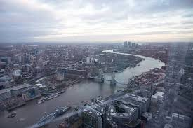 the view from the shard looking out towards tower bridge and canary wharf london