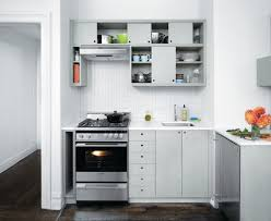 ... White Kitchen Cabinet With Black Ceramic Floor For Small Kitchen  Renovating Ideas ...
