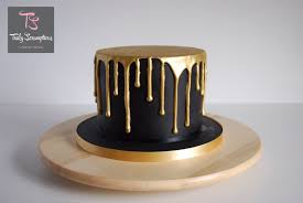 icing has been painted gold you can use your spare fine brush a little clear alcohol to tidy any areas where the gold may have gone onto the cake