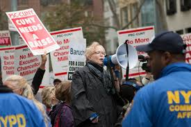 protest essay n democracy essay feminists should not be content  photo essay wake up chancellor milliken the advocate psc union president barbara bowen leads cuny faculty
