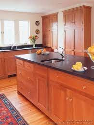 Natural cherry stained cabinets have a hint of red, but the predominant tone is light brown. Shaker Kitchen Cabinets Door Styles Designs And Pictures Wood Kitchen Cabinets Cherry Cabinets Kitchen Best Kitchen Cabinets