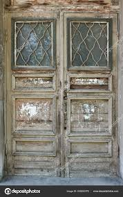 old wooden vine door in the door frame stock photo