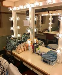 corps de ballet dancer olivia kelly shares a snapshot of her tidy theater spot complete with schedule prepped pointe shoes and head pieces