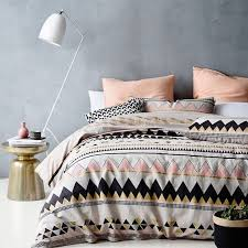 pink white black and gold triangle duvet and pillows in the same shades but