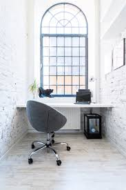 Small home office Cool Heres Tiny Room With Fullwidth Desk Large Arched Window With Original Home Stratosphere 45 Small Home Office Design Ideas photos