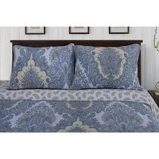 exotic and unique this on trend wave quilt and sham set displays a charming oversized paisley pattern in shades of navy and beige