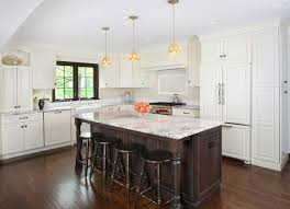 white cabinets dark countertop. large traditional l-shaped dark wood floor kitchen idea in chicago with raised-panel white cabinets countertop c